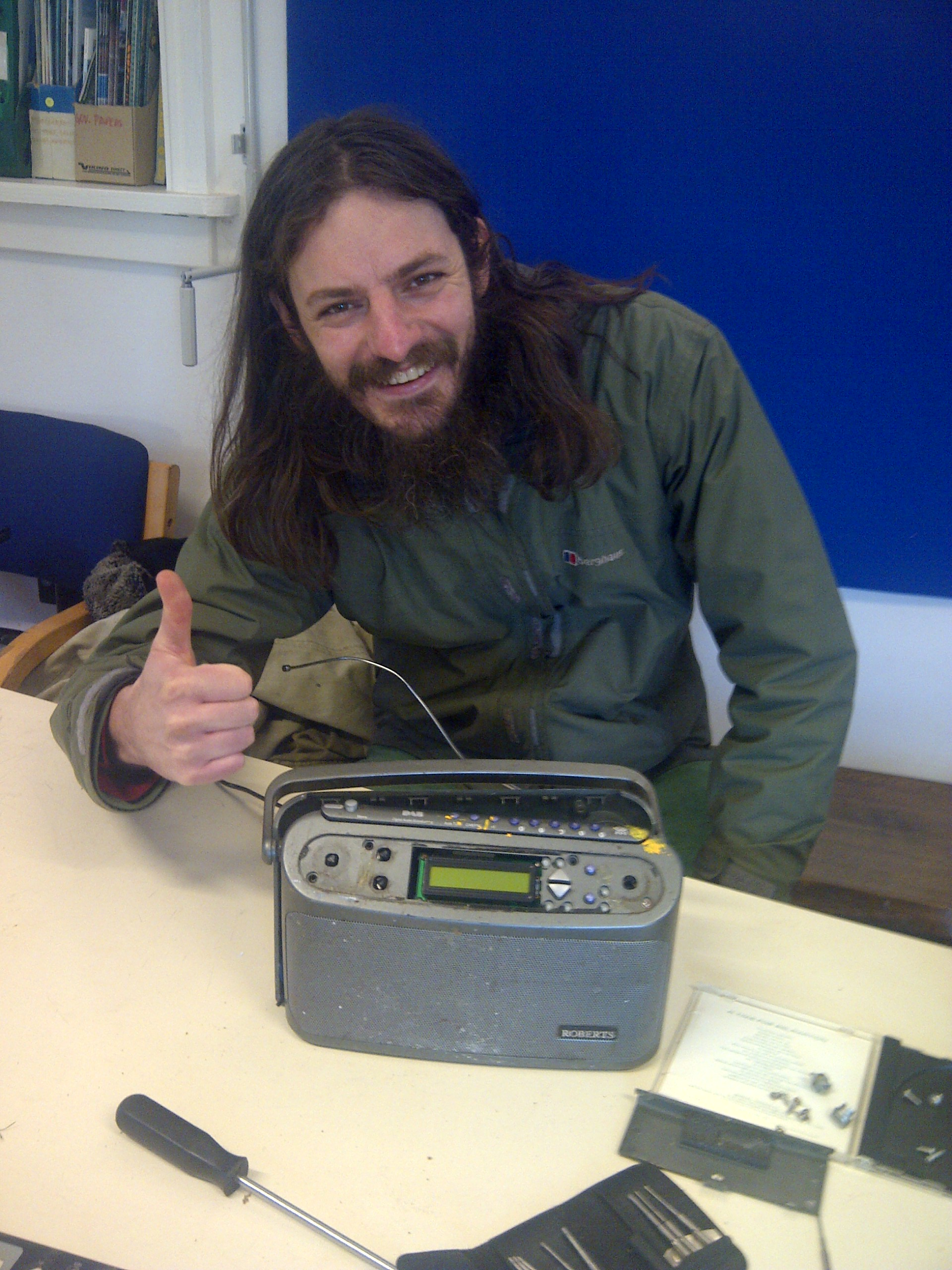 Another satisfied customer, after having his radio repaired.
