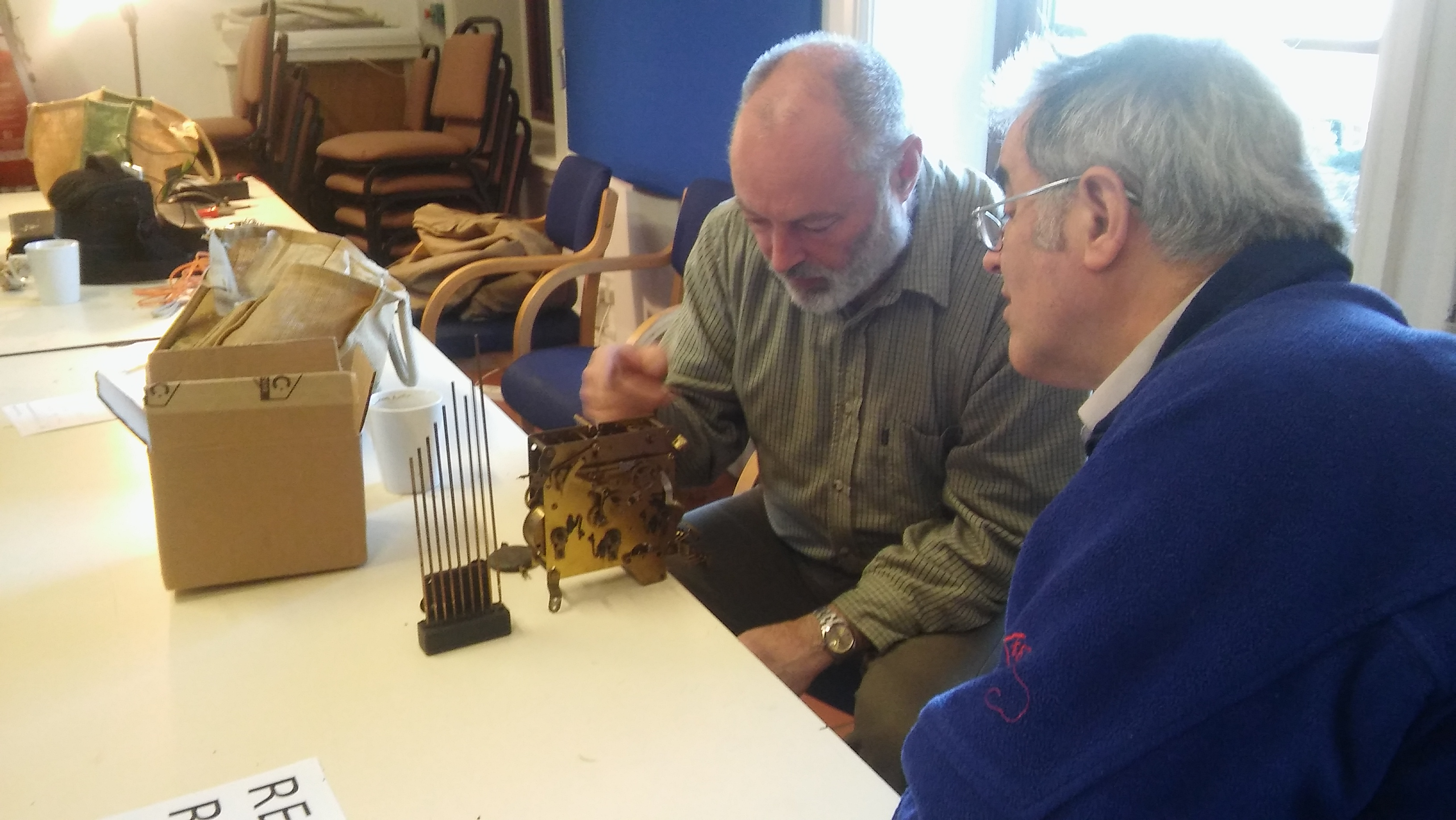 Repairing a clock mechanism at one of our events during 2015.