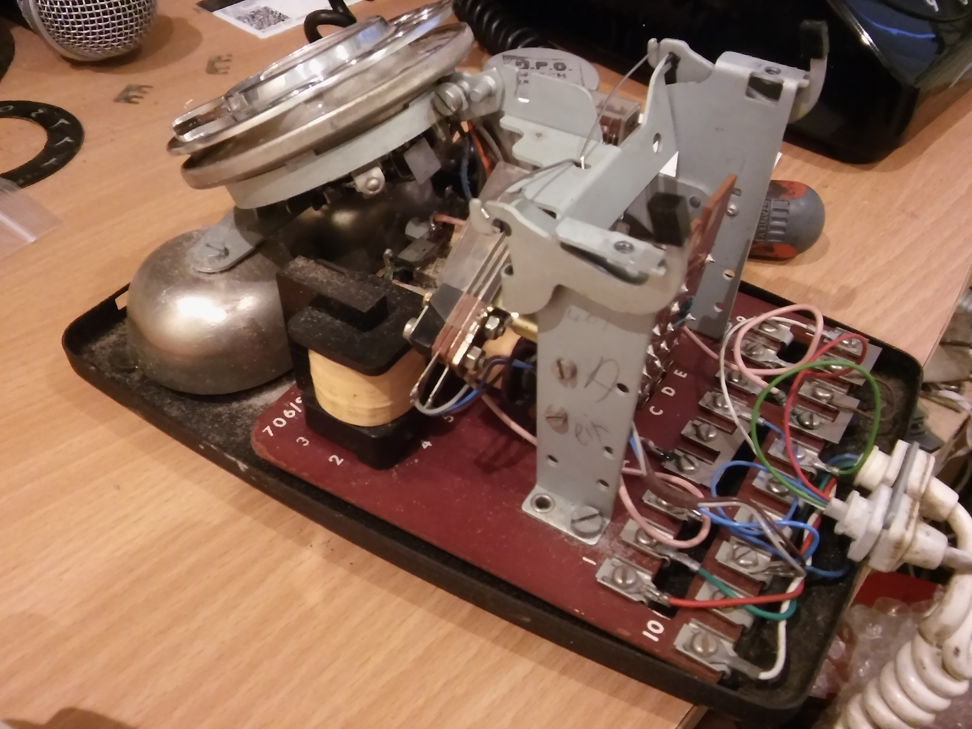 The phone from 1959 with it's plastic cover removed. It's a simple job to re-wire the terminals on the right for modern working with the plug & socket system.